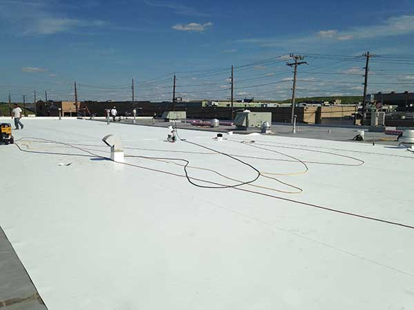 Single-ply TPO being installed by professionals