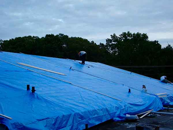 If your building needs commercial emergency roof service, call Anderson Contractors